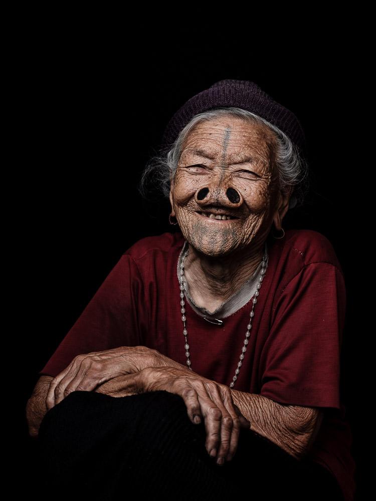 An Apatani Woman with Facial Tattoo and Noseplugs - Arunachal Pradesh, India